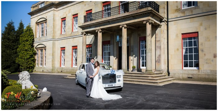 wedding photo outside shrigley hall, cheshire