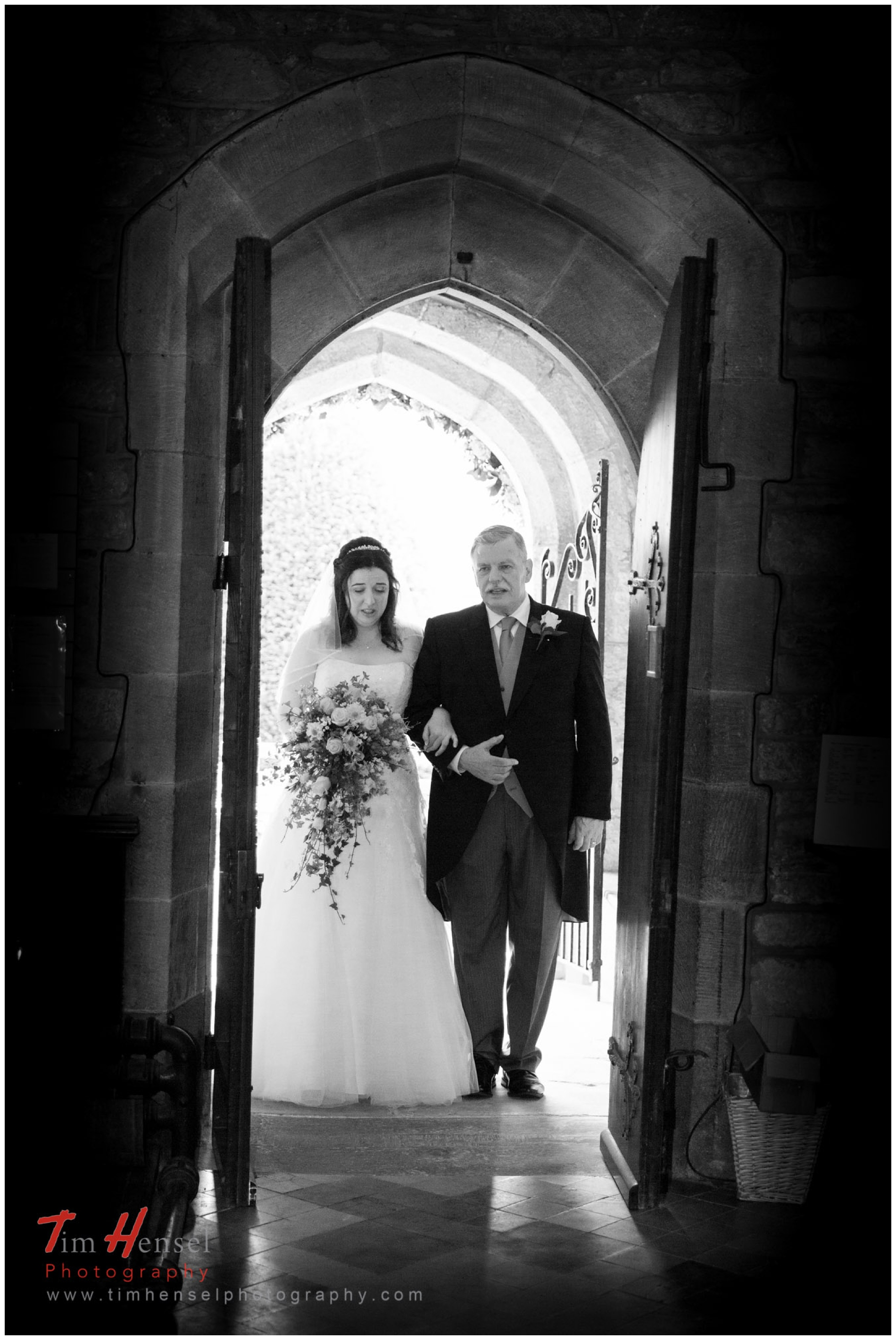 bride and her dad walking into church in derbyshire