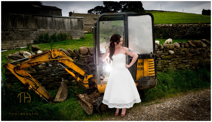A bride and a digger relaxed for rustic farm wedding photography in Derbyshire