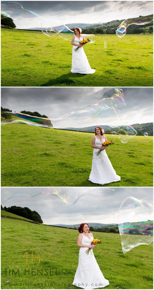 Our Bride with some big bubbles during her wedding photography in Derbyshire