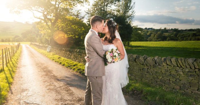 Couple kissing taken by wedding photographer in Kent