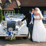 summer wedding photograph with bride and groom in sunglasses